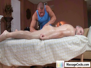 gay fellow takes an oiled up massage and takes