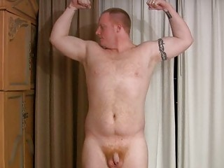 muscular gay hunk demonstrates off his stiff shape