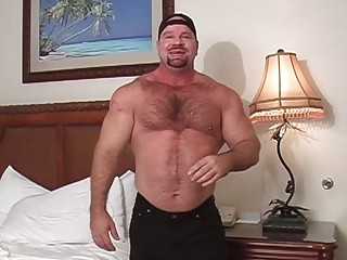 muscular gay guy goes naked inside his bedroom