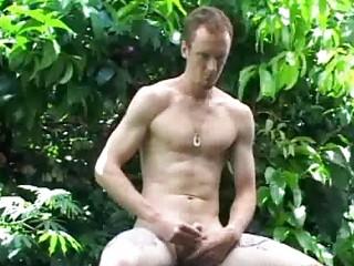 slim gay man jerks off his large prick