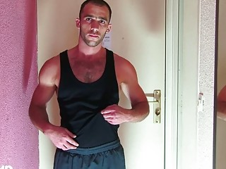 stiff and muscular gay hunk jerks off his large