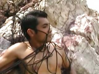gay stud tied up on the sea coast