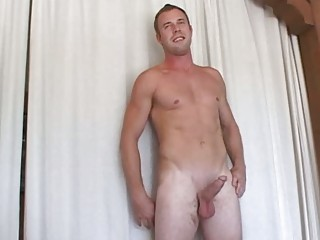 tattooed gay hunk demonstrates off his muscular